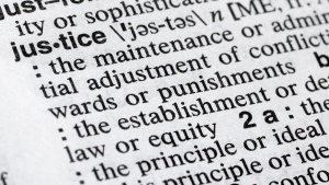 """In this Dec. 12, 2018, photo, """"justice"""" is displayed in a Merriam-Webster dictionary in New York. Merriam-Webster has chosen """"justice"""" as its 2018 word of the year, driven by the churning news cycle and President Trump's Twitter feed. (AP Photo/Mark Lennihan)"""