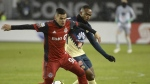 Toronto FC defender Auro (96) battles for the ball with Club America midfielder William Da Silva (7) during first half CONCACAF Champions League semifinal action in Toronto on April 3, 2018. Toronto FC made versatile Brazilian Auro a permanent member of its squad Monday while, looking farther to the future, signing 14-year-old forward Jahkeele Marshall-Rutty to a USL contract. The MLS team exercised its option to buy the 22-year-old Auro, whose full name is Auro Alvaro da Cruz Junior, from Brazilian club Sao Paulo FC. THE CANADIAN PRESS/Nathan Denette