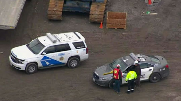 Emergency responders are seen at the scene of a fatal industrial accident on Monday, Dec. 17, 2018.