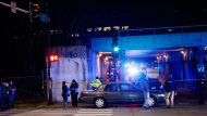 "Police investigate the scene where two officers were killed after they were struck by a South Shore train near 103rd Street and Dauphin Avenue on Monday, Dec. 17, 2018, in Chicago. Police spokesman Anthony Guglielmi posted on Twitter that the ""devastating tragedy"" occurred when the officers were investigating a shots-fired call. (Armando L. Sanchez/Chicago Tribune via AP)"
