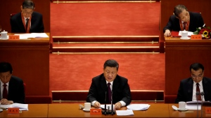 Chinese President Xi Jinping speaks during a conference to commemorate the 40th anniversary of China's Reform and Opening Up policy at the Great Hall of the People in Beijing, Tuesday, Dec. 18, 2018. China will never seek hegemony, President Xi Jinping said Tuesday as global concerns persist over the country's growing economic influence. (AP Photo/Mark Schiefelbein)