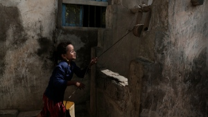 A girl pulls water from a well in the home of Ahmed al-Kawkabani, leader of the southern resistance unit in Hodeida, in al-Khoukha, Yemen Feb. 12, 2018. (AP Photo/Nariman El-Mofty)