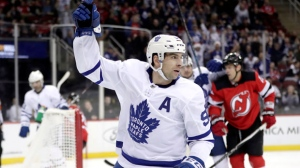 Toronto Maple Leafs center John Tavares celebrates his first period goal against the New Jersey Devils during an NHL hockey game, Tuesday, Dec. 18, 2018, in Newark, N.J. (AP Photo/Julio Cortez)
