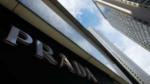 In this June 12, 2011, file photo, a logo of Prada is seen at a store in Hong Kong. (AP Photo/Vincent Yu, File)
