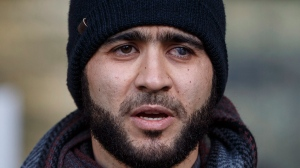 Omar Khadr speaks outside court in Edmonton on Thursday, December 13, 2018. THE CANADIAN PRESS/Jason Franson