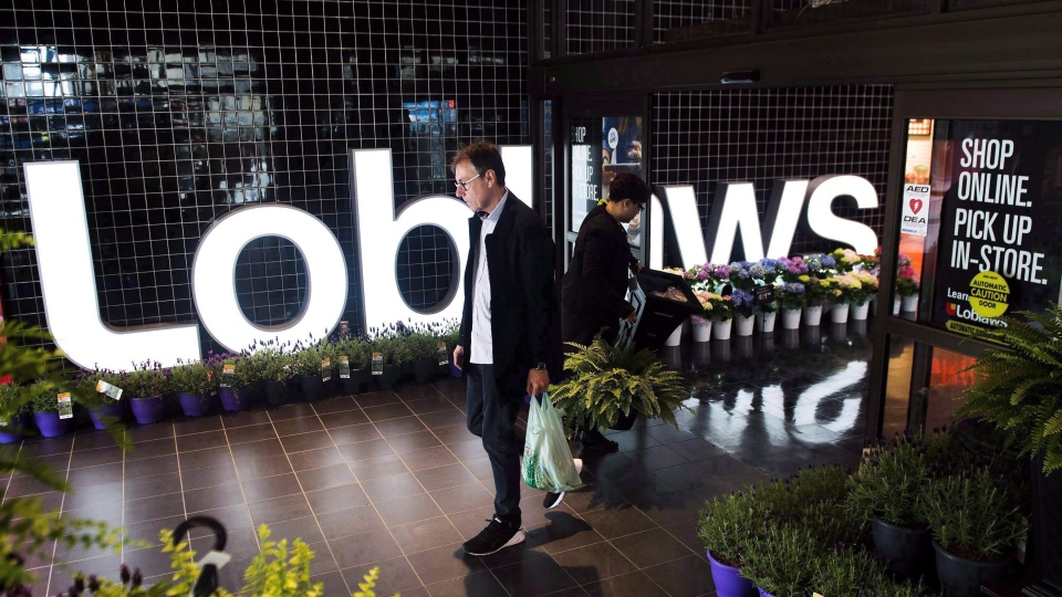 A man leaves a Loblaws store in Toronto on Thursday, May 3, 2018. THE CANADIAN PRESS/Nathan Denette