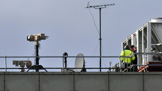 Counter drone equipment is deployed on a rooftop at Gatwick airport in Gatwick, England, Friday, Dec. 21, 2018. Flights resumed at London's Gatwick Airport on Friday after drones sparked about 36 hours of travel chaos including the shutdown of the airfield, leaving tens of thousands of passengers stranded or delayed during the busy holiday season. (John Stillwell/PA via AP)