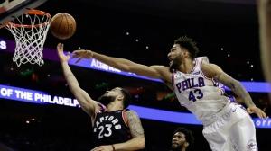 Toronto Raptors' Fred VanVleet (23) goes up for a shot against Philadelphia 76ers' Jonah Bolden (43) during the first half of an NBA basketball game, Saturday, Dec. 22, 2018, in Philadelphia. (AP Photo/Matt Slocum)