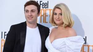 """In an April 17, 2018 file photo, Meghan Trainor, right, and Daryl Sabara arrive at the world premiere of """"I Feel Pretty"""" at the Westwood Village Theater in Los Angeles. A publicist for the Grammy-winning singer on Sunday, Dec. 23, 2018 confirmed that Meghan Trainor wed actor Daryl Sabara in nuptial exchanged at the couple's Los Angeles home on Saturday. (Photo by Jordan Strauss/Invision/AP, File)"""