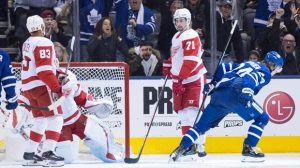 Toronto Maple Leafs right wing Kasperi Kapanen (right) turns after scoring his team's opening goal as Detroit Red Dylan Larkin (71) looks on during first period NHL hockey action in Toronto, on Sunday, December 23, 2018.THE CANADIAN PRESS/Chris Young