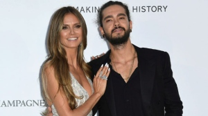In this May 17, 2018, file photo, model Heidi Klum, left, and musician Tom Kaulitz pose for photographers upon arrival at the amfAR, Cinema Against AIDS, benefit at the Hotel du Cap-Eden-Roc, during the 71st international Cannes film festival, in Cap d'Antibes, southern France. (Photo by Arthur Mola/Invision/AP, File)