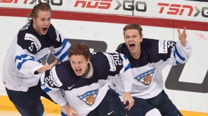 Kasperi Kapanen expects there will be some good natured chirping in the Toronto Maple Leafs locker-room when the world junior hockey championship begins on Boxing Day. Finland's Kasperi Kapanen (centre) celebrates his game-winning goal in overtime against Russia with teammates Joni Tuulola (left) and Vili Saarijarvi (right) during gold medal game hockey action at the IIHF World Championship, in Helsinki, Finland, on Tuesday, Jan. 5, 2016. THE CANADIAN PRESS/Sean Kilpatrick