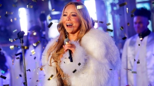In this Dec. 31, 2017 file photo, Mariah Carey performs at the New Year's Eve celebration in Times Square in New York.  (Photo by Brent N. Clarke/Invision/AP, File)