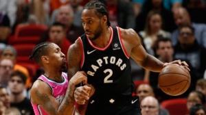 Miami Heat guard Rodney McGruder (17) defends against Toronto Raptors forward Kawhi Leonard (2) during the second half of an NBA basketball game Wednesday, Dec. 26, 2018, in Miami. Toronto defeated Miami 106-104. (AP Photo/Joel Auerbach)