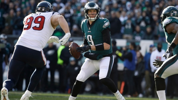 ad6523fe70d 23, 2018, file photo, Philadelphia Eagles quarterback Nick Foles looks for  a receiver as Houston Texans's J.J. Watt rushes during the first half an NFL  ...