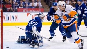 New York Islanders centre Mathew Barzal (13) scores on Toronto Maple Leafs goaltender Garret Sparks (40) during second period NHL hockey action in Toronto on Saturday, December 29, 2018. THE CANADIAN PRESS/Frank Gunn
