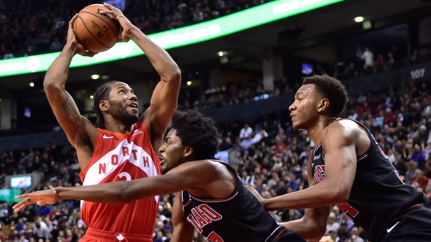 3ee4352dc Toronto Raptors forward Kawhi Leonard (2) goes to the net against Chicago  Bulls forward Justin Holiday (7) and forward Wendell Carter Jr. (34) during  second ...