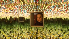 "A woman looks at Yayoi Kusama's ""Love Forever,"" part of the ""Yayoi Kusama: Infinity Mirrors,"" exhibition at the Art Gallery of Ontario in Toronto on Tuesday, February 27, 2018. THE CANADIAN PRESS/Chris Young"