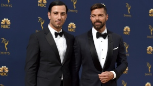 In this Monday, Sept. 17, 2018, file photo, Jwan Yosef, left, and Ricky Martin arrive at the 70th Primetime Emmy Awards at the Microsoft Theater in Los Angeles. Martin announced the arrival of his daughter with an Instagram post showing off the infant's tiny hands. Martin says he and his artist husband Jwan Yosef have named the girl Lucia. (Photo by Jordan Strauss/Invision/AP, File)