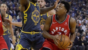 Toronto Raptors guard Kyle Lowry, right, is defended by Golden State Warriors forward Jordan Bell (2) during the first half of an NBA basketball game in Oakland, Calif., Wednesday, Dec. 12, 2018. (AP Photo/Jeff Chiu)