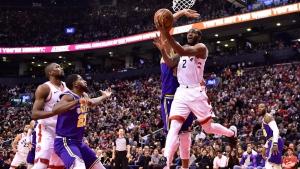 Toronto Raptors forward Kawhi Leonard (2) scores against the Utah Jazz during second half NBA basketball action in Toronto on Tuesday, January 1, 2019. THE CANADIAN PRESS/Frank Gunn