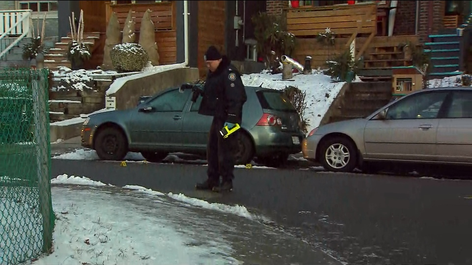 A forensics officer is shown investigating at the scene of a shooting on Walpole Avenue in the city's east end on Friday morning.