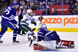 Minnesota Wild left wing Zach Parise (centre) celebrates his goal past Toronto Maple Leafs goaltender Michael Hutchinson (30) as Leafs defenceman Nikita Zaitsev (22) looks on during third period NHL hockey action in Toronto on Thursday, Jan.3, 2019. THE CANADIAN PRESS/Frank Gunn