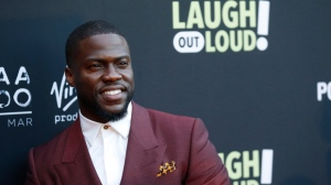 "In this Aug. 3, 2017 file photo, Kevin Hart poses at Kevin Hart's ""Laugh Out Loud"" new streaming video network launch event at the Goldstein Residence in Beverly Hills, Calif.  Prodded by Ellen DeGeneres,  Hart says he'll reconsider his decision to step down as host of the Academy Awards. Two days after he was named as host last Dec. 2018, Hart backed off when some of his homophobic tweets from a decade ago resurfaced. (Photo by Danny Moloshok/Invision/AP, File)"