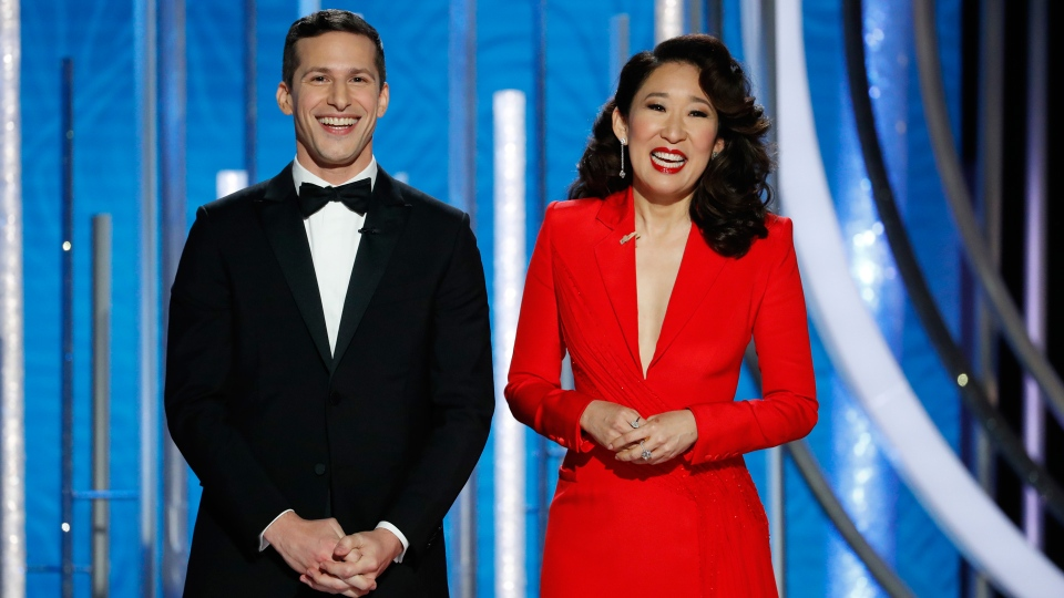 This image released by NBC shows hosts Andy Samberg, left, and Sandra Oh at the 76th Annual Golden Globe Awards at the Beverly Hilton Hotel on Sunday, Jan. 6, 2019, in Beverly Hills, Calif. (Paul Drinkwater/NBC via AP)