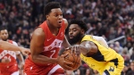 Toronto Raptors guard Kyle Lowry (7) drives past Indiana Pacers guard Tyreke Evans (12) during first half NBA basketball action in Toronto on Sunday, Jan. 6, 2019. THE CANADIAN PRESS/Nathan Denette