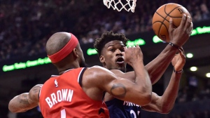 Minnesota Timberwolves guard Jimmy Butler (23) drives to the net as Toronto Raptors guard Lorenzo Brown (4) defends during second half NBA action in Toronto on Wednesday, Oct. 24, 2018. THE CANADIAN PRESS/Frank Gunn