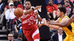 Toronto Raptors forward Norman Powell (24) passes the ball as Indiana Pacers forward Doug McDermott (20) and forward Thaddeus Young (21) look on during second half NBA basketball action in Toronto on Sunday, Jan. 6, 2019. THE CANADIAN PRESS/Nathan Denette