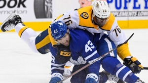 Nashville Predators defenceman P.K. Subban (76) battles with Toronto Maple Leafs centre Nazem Kadri (43) during first period NHL Hockey action in Toronto on Monday, January 7, 2019. THE CANADIAN PRESS/Nathan Denette