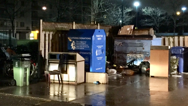Woman dies after becoming stuck inside clothing bin, police say
