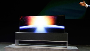 The LG Signature OLED TV R, partially rolled up, is on display during an LG news conference at CES International, Monday, Jan. 7, 2019, in Las Vegas. (AP Photo/John Locher)