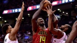 Atlanta Hawks centre Dewayne Dedmon (14) tries to drive to the net as Toronto Raptors guard Kyle Lowry (7) and teammate Kawhi Leonard (2) defend during second half NBA basketball action in Toronto on Tuesday, Jan. 8, 2019. THE CANADIAN PRESS/Frank Gunn