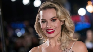"In this Monday, Dec. 10, 2018, file photo, actress Margot Robbie poses for photographers upon her arrival at the premiere of the film ""Mary Queen of Scots,"" in London. (Photo by Vianney Le Caer/Invision/AP, File)"