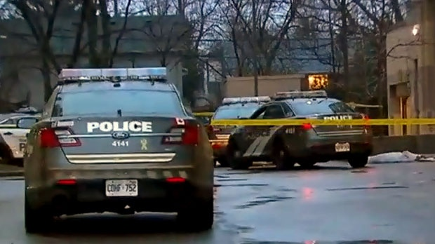 Toronto police are seen investigating the death of a man and a woman at an apartment building in the city's Scarborough Junction neighbourhood on Jan. 8, 2019.