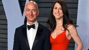 In this March 4, 2018 file photo, Jeff Bezos and wife MacKenzie Bezos arrive at the Vanity Fair Oscar Party in Beverly Hills, Calif.  Bezos says he and his wife, MacKenzie, have decided to divorce after 25 years of marriage. Bezos, one of the world's richest men, made the announcement on Twitter Wednesday, Jan. 9, 2019. (Photo by Evan Agostini/Invision/AP, File)
