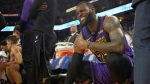 In this Dec. 25, 2018, file photo, Los Angeles Lakers forward LeBron James (23) reacts after straining his left groin during the second half of an NBA basketball game against the Golden State Warriors in Oakland, Calif. (AP Photo/Tony Avelar, File)