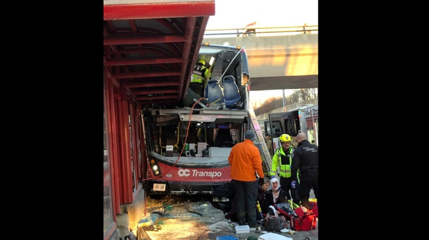 A double decker OC Transpo bus is shown at Westboro Transitway Station on Jan. 11, 2019 after a serious collision. (@KarinaWieser/Twitter)