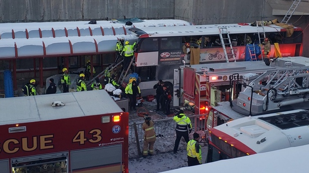 Paramedics and firefighters assist passengers on a OC Transpo bus that struck a shelter structure on Jan. 11, 2019. (Patrick Carriere)