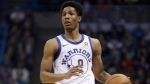 In this Jan. 12, 2018 file photo, Golden State Warriors' Patrick McCaw dribbles during the first half of an NBA basketball game against the Milwaukee Bucks in Milwaukee. McCaw is practicing with the Cavaliers, who signed him to a two-year, $6 million offer sheet last week. McCaw officially joined the Cavaliers' roster on Monday, Dec. 31 after Golden State decided not to match Cleveland's offer. (AP Photo/Morry Gash, File)