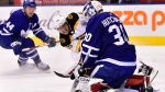 Toronto Maple Leafs goaltender Michael Hutchinson (30) stops Boston Bruins right wing David Pastrnak (88)during third period NHL hockey action in Toronto on Saturday, Jan.12, 2019. THE CANADIAN PRESS/Frank Gunn