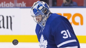Toronto Maple Leafs goaltender Frederik Andersen keeps his eyes on the puck as he makes a stop during third period NHL hockey action against the Boston Bruins in Toronto on November 26, 2018. THE CANADIAN PRESS/Chris Young