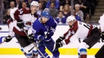 Toronto Maple Leafs right wing William Nylander (29) battles for the puck between Colorado Avalanche centre Carl Soderberg (34) and defenceman Mark Barberio (44) during second period NHL hockey action in Toronto on Monday, January 14, 2019. THE CANADIAN PRESS/Cole Burston