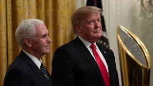 President Donald Trump, right, and Vice President Mike Pence, left, listen during a reception for the Clemson Tigers in the East Room of the White House in Washington, Monday, Jan. 14, 2019. (AP Photo/Susan Walsh)