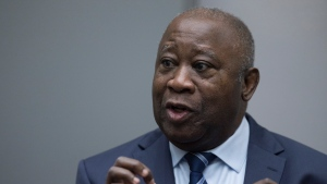 Former Ivory Coast President Laurent Gbagbo enters the courtroom of the International Criminal Court in The Hague, Netherlands, Tuesday, Jan. 15, 2019, where judges acquitted Gbagbo and ex-government minister Charles Ble Goude of crimes committed during the 2010 election for lack of evidence. (AP Photo/Peter Dejong, Pool)