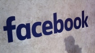 This Jan. 17, 2017, file photo shows a Facebook logo displayed in a start-up companies gathering at Paris' Station F in Paris. (AP Photo/Thibault Camus, File)