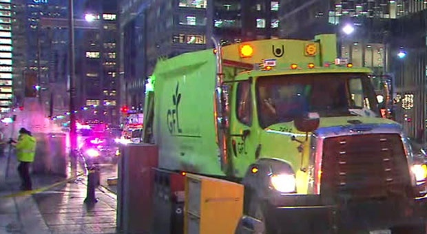 A person who was struck and killed by a garbage truck in the Financial District on Tuesday morning was sleeping in a laneway when they were hit.